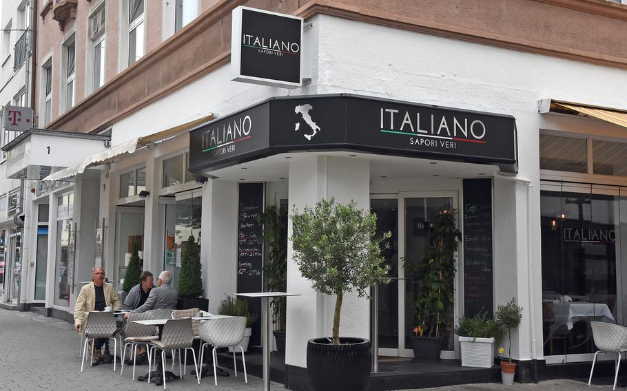 Diners sit outside Italiano Sapori Veri on a recent summery day in Kaiserslautern, Germany.