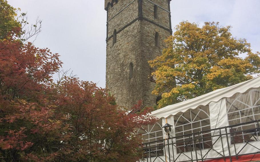 A view of the beer garden and observation tower at Berggasthof Kellerskopf, a rustic restaurant set in the wooded hills outside of Wiesbaden, Germany. Located in the midst of several major hiking and biking trails, the restaurant welcomes hikers and bikers to sit in its beer garden after a long workout.