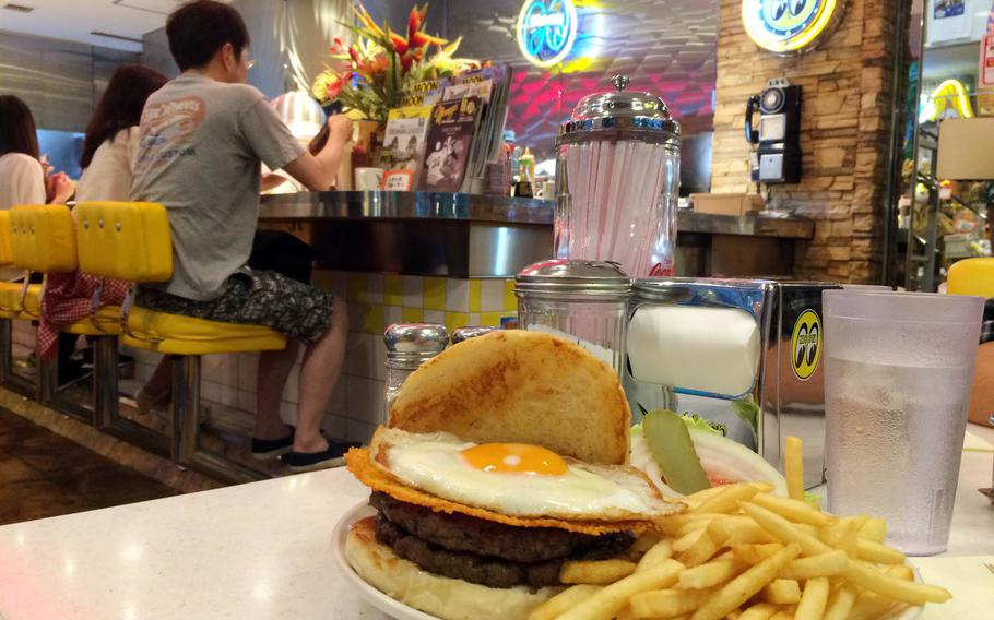 The Dead Moon Burger is the No. 1 item on MOON Cafe's menu. This basic burger, which comes with fresh, thin, crunchy fries, is pretty plain; however, you can add items such as crispy cheese, egg, bacon, onion and mushrooms for an additional charge.
