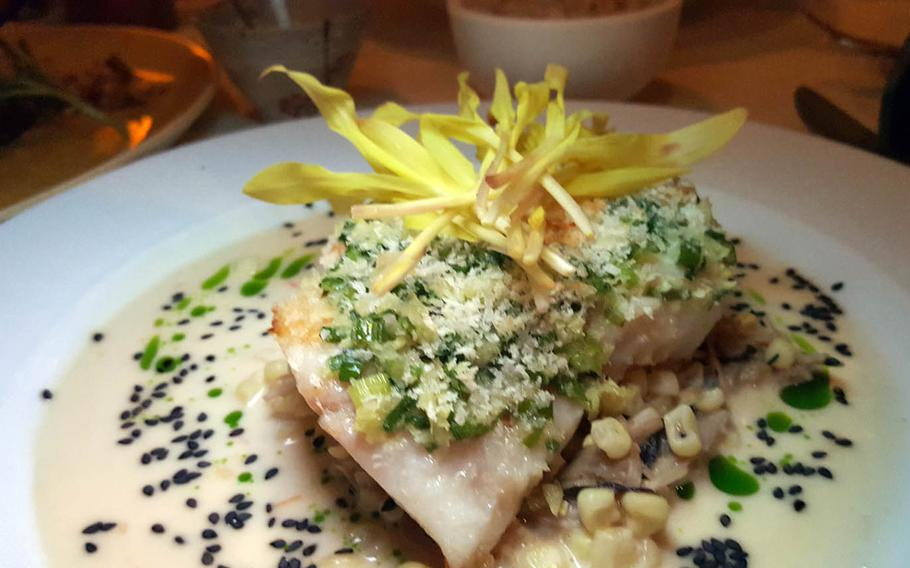 Alan Wong's ginger-crusted onaga, capped with a miso-sesame vinaigrette and surrounded with mushrooms and corn, has been on the menu since the Honolulu restaurant opened in 1995.