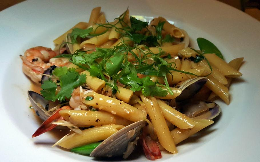 The shrimp and clams penne from Alan Wong's in Honolulu is steeped in a black bean sauce infused with chili, garlic and lemongrass.