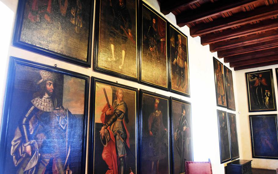 Large paintings of the ancestors of Holy Roman Emperor Charles IV hang from the walls in the Karlstejn Castle in the Czech Republic.