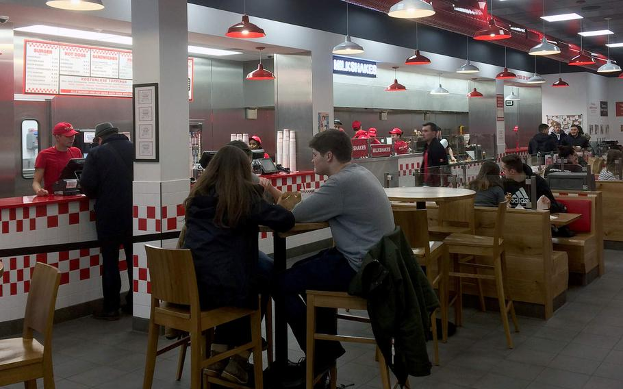Customers order and eat at Five Guys in Frankfurt, Germany. The chain opened its Frankfurt location - the first in Germany - in December.