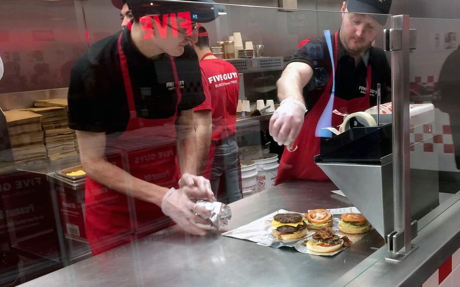 Workers prepare burgers at Five Guys in Frankfurt, Germany. The American chain opened its first restaurant in Germany in December.