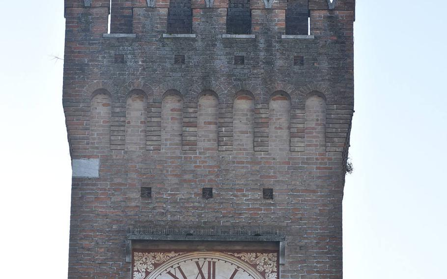 The clock tower that tops the original city hall in Oderzo, Italy, rises above the piazza that runs in front of the Duomo and is one of a series of squares that serve as the heart of the city.
