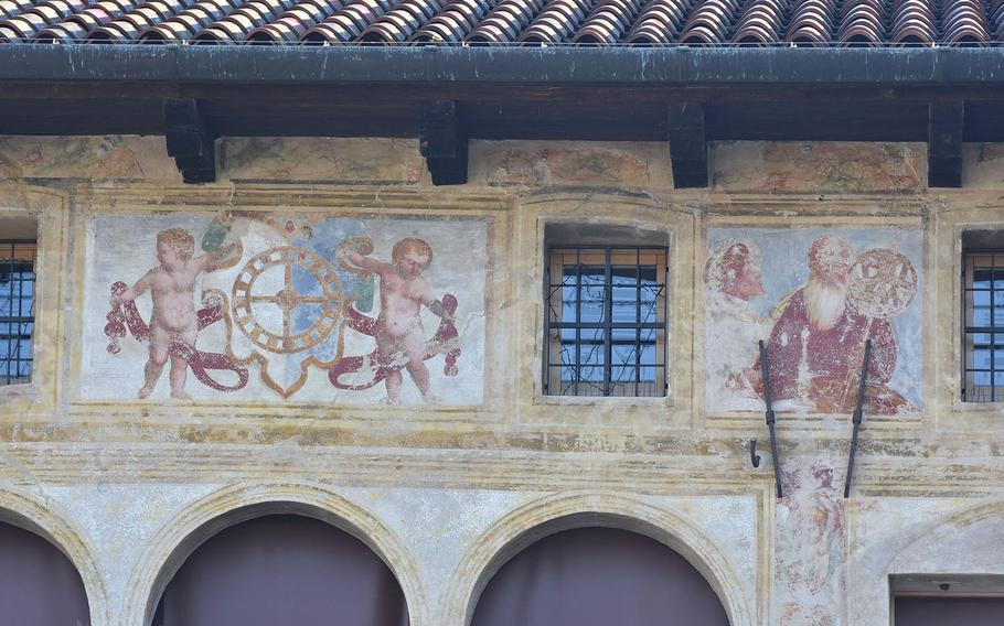 Frescoes adorn the exterior of a building in downtown Oderzo, italy.