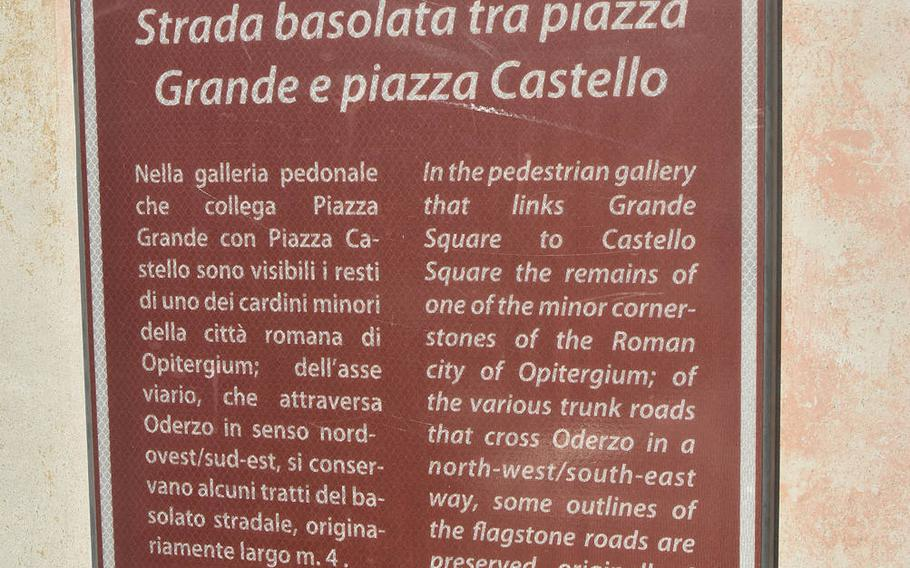 Signs such as this one inform tourists of significant sites in the city of Oderzo, Italy.