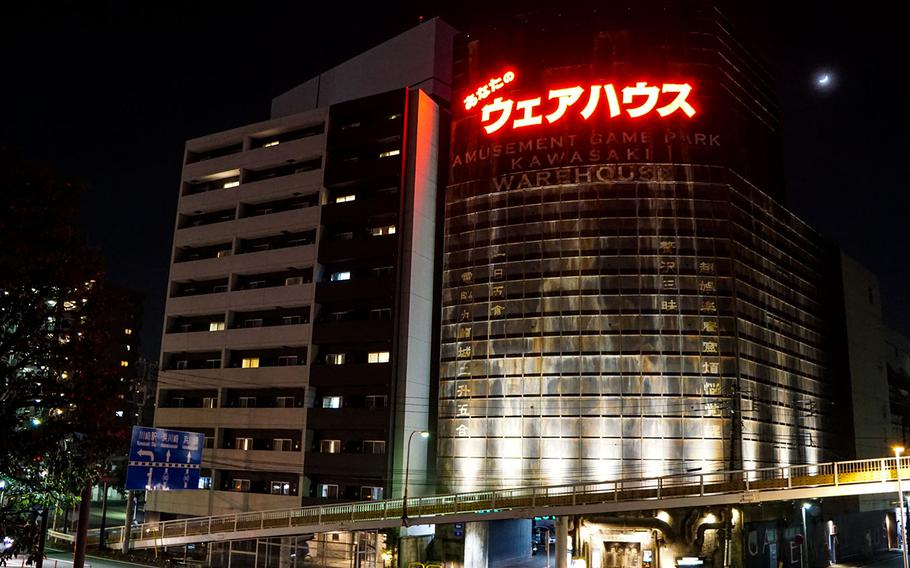 There's a stark contrast between the rundown appearance of Anata No Warehouse compared with its neighboring buildings in Kawasaki, Japan.