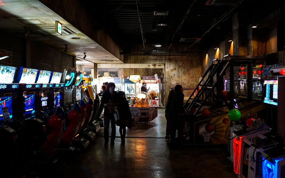 Anata No Warehouse in Kawasaki, Japan, features an extensive collection of arcade machines, such as these racing and shooting games.