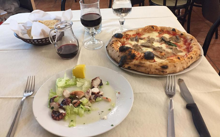 At the Pizzeria Trattoria Lucrino in Pozzuoli, Italy, you can have a very Italian combination of octopus salad, pizza and wine and at a reasonable price.