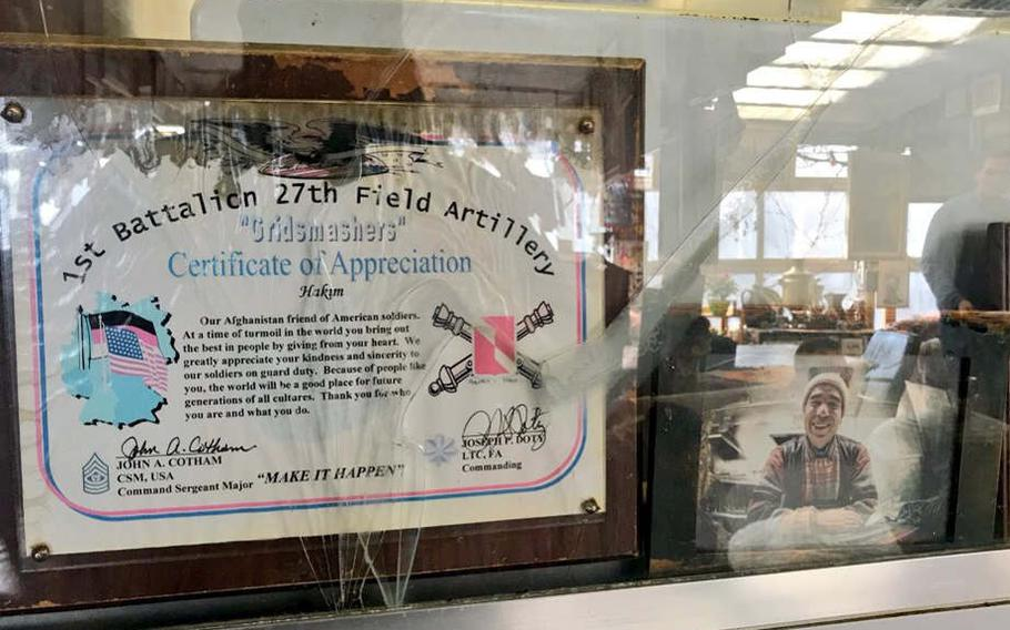 """A certificate of appreciation to Hakim, """"our Afghanistan friend of American soldiers"""" is displayed in the window of the recreational vehicle that serves as a kitchen at Hakim's Imbiss and Steak House, Heidelberg, Germany."""