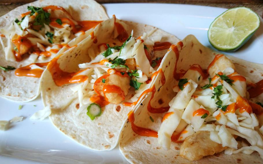Among the items on the menu of Amigos Mexican Restaurant in Bury St. Edmunds, England, are Baja fish tacos with battered fish sprinkled in lime, bits of cabbage and chipotle sauce.