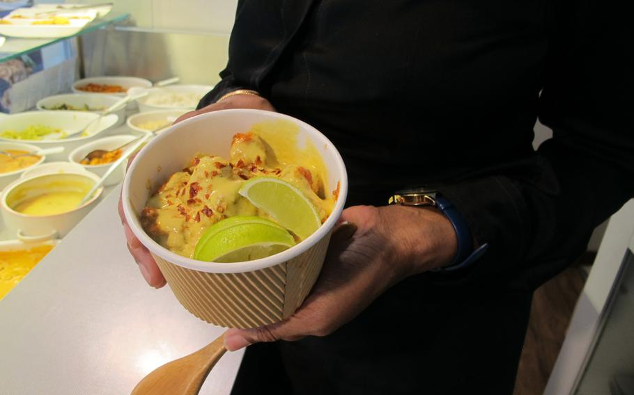 Khao-suey, a Burmese soup redolent of chicken curry, coconut broth and fresh lime, is made using a recipe from Ameen's father's one-time fiancee's uncle.
