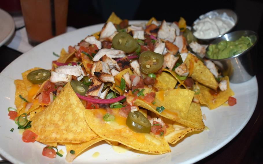 Starters like this plate of nachos offer a good option to keep the tab under control. The generous appetizer is a few pounds cheaper than a burger and many other entrees.