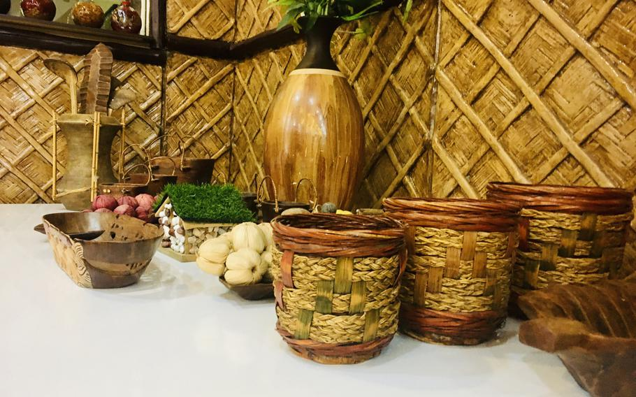 """Handicrafts from Philippines decorate the Bahay Kubo restaurant in Manama, Bahrain. The name of the restaurant, which serves delicious, authentic Filipino food, means """"nipa hut,"""" a small house on stilts that is representative of the culture of the archipelago  nation."""