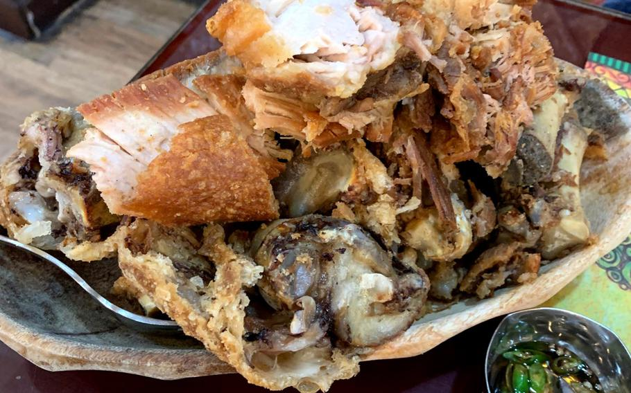 Filipino crispy pata, a deep-fried pork knuckle, will feed four people at Bahay Kubo restaurant in Manama Bahrain. Bahrain is home to more than 40,000 Filipino nationals and dozens of authentic pinoy eateries can be found in Manama.
