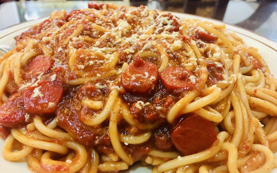 Filipino spaghetti, served with a sweetened sauce and hotdogs, is a quick and delicious lunch or can be made to order for large groups at Bahay Kubo restaurant in Manama, Bahrain.