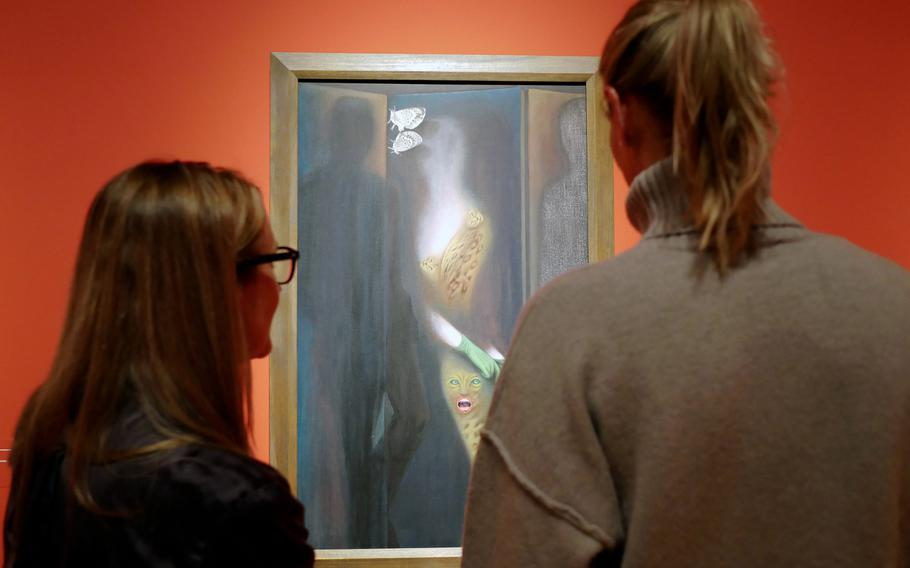 """Two visitors to the exhibit """"Fantastic Women"""" at the Schirn exhibit hall in Frankfurt, Germany, discuss Toyen's """"The Paravent."""" The exhibit runs through July 5."""