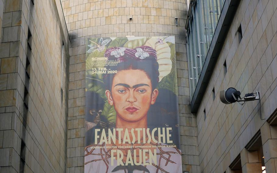 """The new exhibit at the Schirn exhibit hall in Frankfurt, Germany, is """"Fantastische Frauen,"""" or """"Fantastic Women,"""" and features Frieda Kahlo's famous """"Self-Portrait with Thorn Necklace and Hummingbird"""" on its posters and ads. The exhibit runs through July 5."""