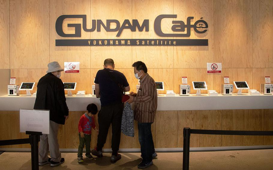 Gundam Cafe inside the dock area at Gundam Factory Yokohama serves a variety of burgers, pasta dishes and beverages.