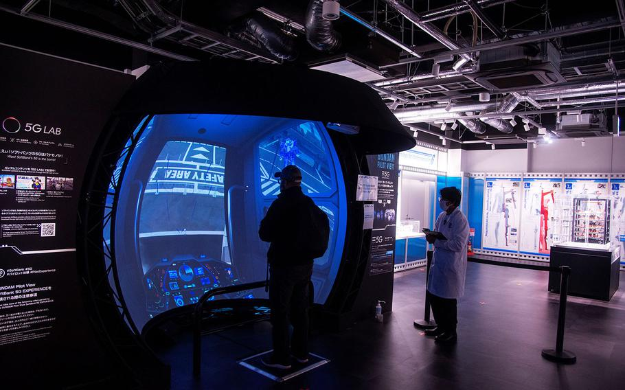 The pilot view experience at Gundam Factory Yokohama is linked to the full-size robot outside and shows you what it would be like to be at the controls inside the cockpit of a real Gundam.