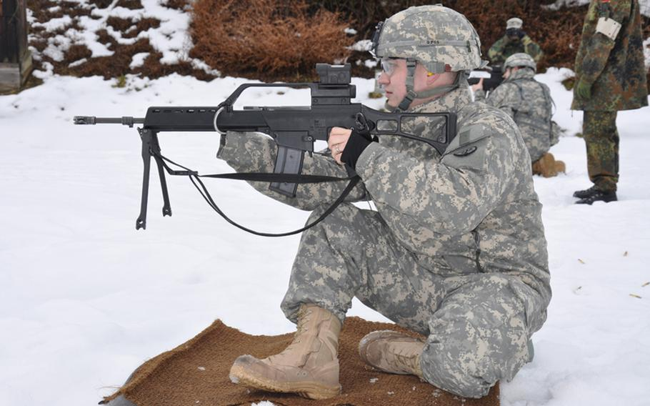 Spc. Jake Altman eyes his target while competing for the German proficiency badge at the German Infantry School in Hammelburg, Germany, in February.