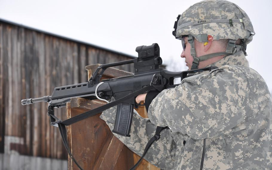 Spc. Jake Altman aims at his target while competing for the German proficiency badge at the German Infantry School in Hammelburg, Germany, in February.