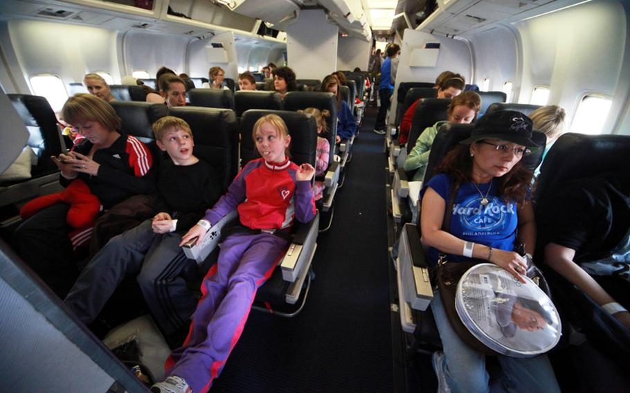 U.S. military family members prepare to take off from Yokota Air Base, Japan, last month as part of the authorized voluntary dependent departure. The Defense Department lifted the departure order Friday - allowing dependents to return to Japan.