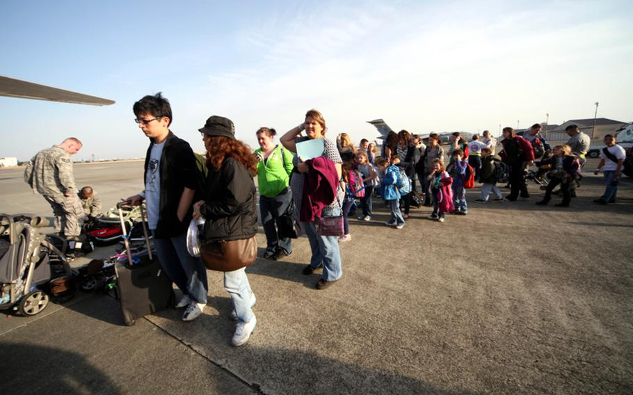 Following the quake and tsunami that hit Japan on March 11, U.S. military family members board a flight from Yokota Air Base, Japan, bound for to Seattle.