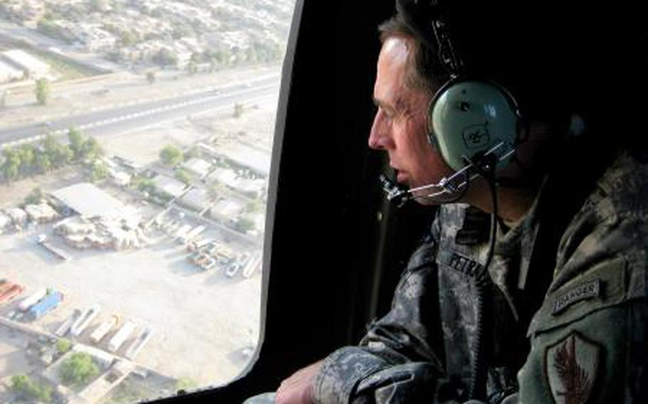 U.S. Army Gen. David H. Petraeus flying over Baghdad in July 2009.
