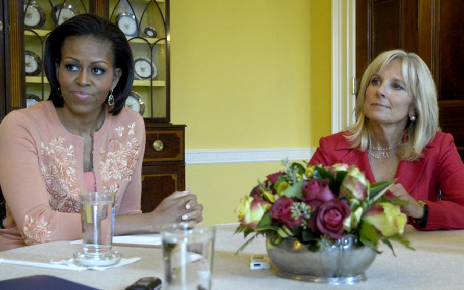 First lady Michelle Obama and Dr. Jill Biden, wife of Vice President Joe Biden, listen to a question about the Joining Forces program for military families Tuesday at the White House.