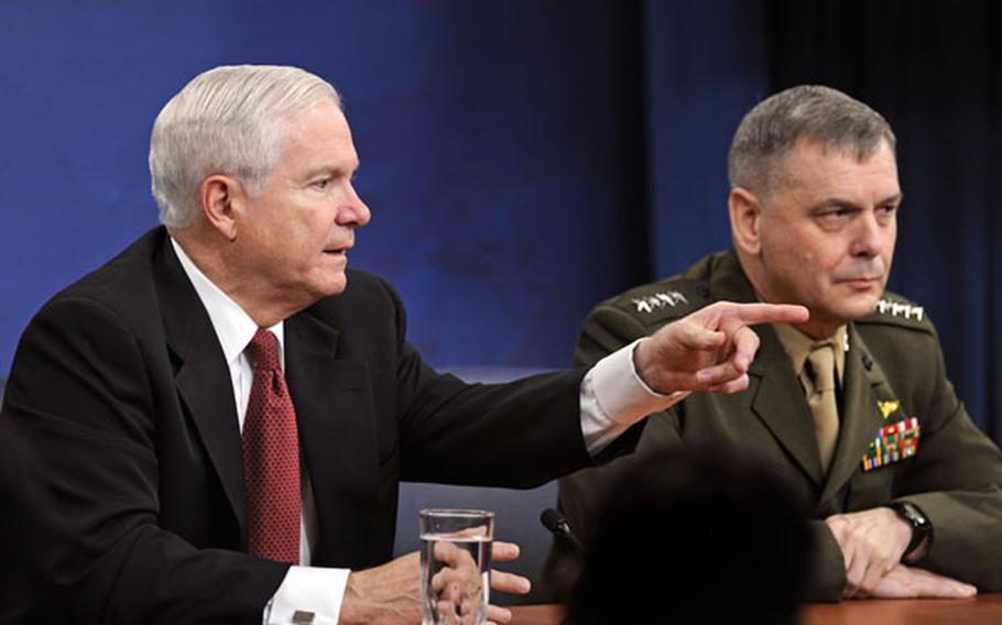 Defense Secretary Robert Gates and Gen. James Cartwright attend a news conference April 21.