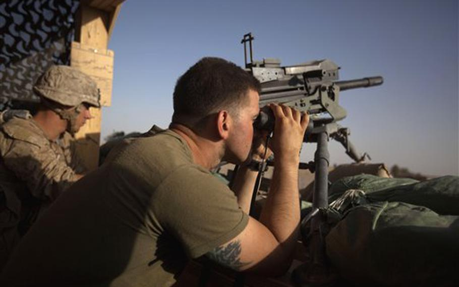 U.S. Marine Capt. Mark Paige, 26, of Port Jefferson Station, N.Y., with the 3rd Battalion, 2nd Marines, based in Camp Lejeune, N.C., watches an insurgent planting a roadside bomb from a guard post at Patrol Base Salaam Bazaar in Helmand province, Afghanistan, on July 23, 2011. Recently a remote-controlled toy truck with a camera mounted on it saved the lives of six soldiers in Afghanistan when it detonated a roadside bomb as it moved ahead of troops while they were on patrol.