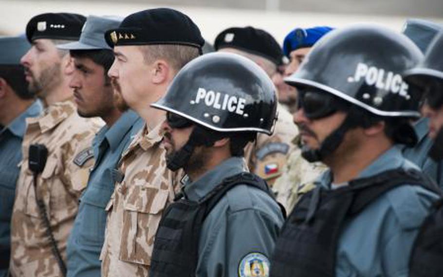 Afghan National Police instructors stand alongside NATO Training Mission-Afghanistan advisers at the National Police Training Center in Wardak province, Afghanistan in April 2011.