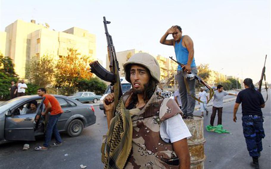 Libyan rebels roam the streets of the Abu Salim district in Tripoli, Libya, on Aug. 25, 2011.