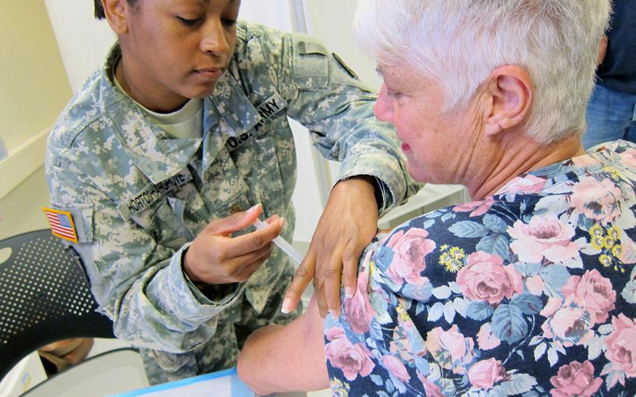 Arnhild Leggett, 63, of Zweibrücken, receives her flu shot Friday at Landstuhl Regional Medical Center in Germany. With winter fast approaching, flu shots drew hundreds of people to Landstuhl's health fair, where visitors also learned about various agencies there, including family practice, pharmacy, dental and retiree services.