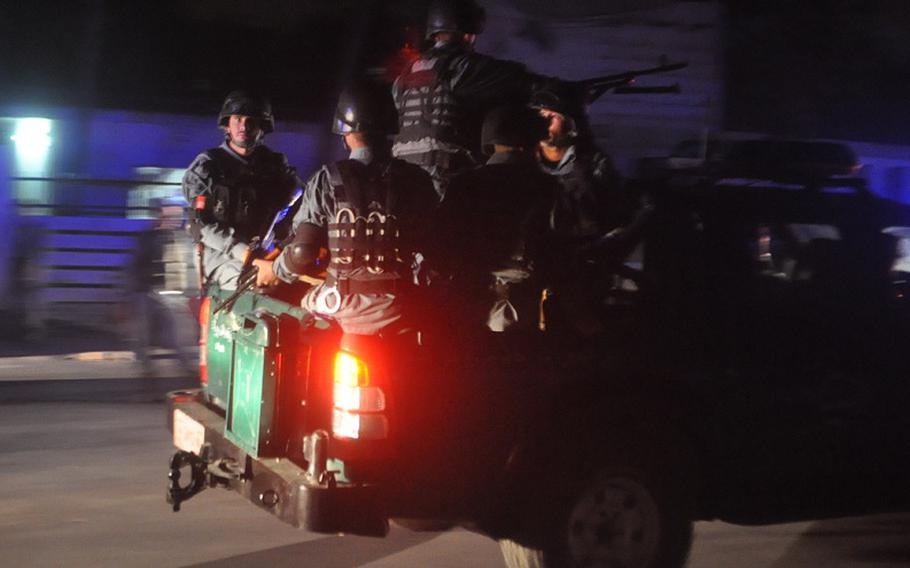 Armed Afghan police respond to the scene of a bomb attack that killed former Afghanistan President Burhanuddin Rabbani at his home in Kabul. Rabbani, head of the country's High Peace Council, had been closely involved in negotiations with the Taliban to end the decade-long war in Afghanistan.