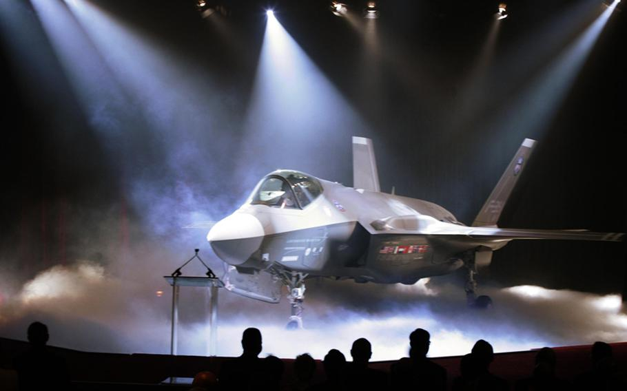 The F-35 Lightning II Joint Strike Fighter is unveiled at a ceremony, Friday, July 7, 2006, in a hanger at Lockheed Martin in Fort Worth, Texas.
