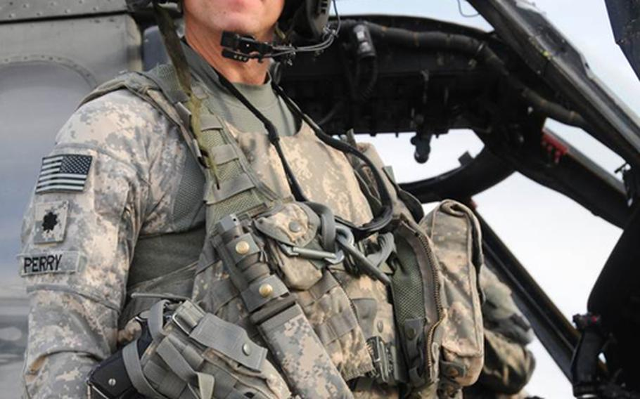 Republican Scott Perry, who is running for a U.S. House seat in Pennsylvania's 4th district pictured with a Blackhawk helicopter in 2012. Perry is a helicopter pilot and a colonel in the Pennsylvania Army National Guard, who flew 44 missions and served 200 combat hours in the Iraq War during 2009 and 2010.
