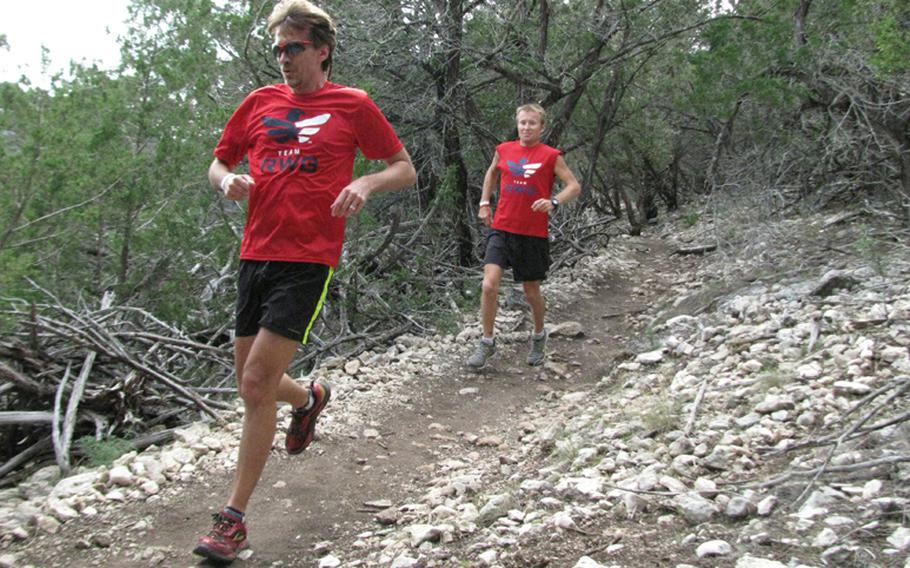 Doug Ratliff (left) and Army Master Sgt. Mike Morton speed down a hillside during Team Red, White & Blue's November running camp in west Texas.