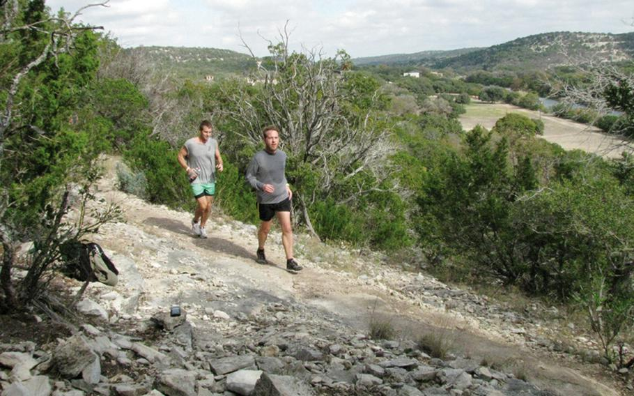 Army veterans Jim Buzzell (right) and Dustin Levijoki speed up a mountainside during Team Red, White & Blue's November running camp in west Texas.
