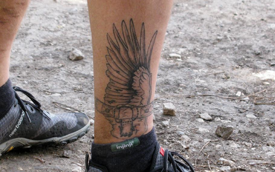 Matching tattoos on Army veteran Jim Buzzell's legs reflect his love of running.
