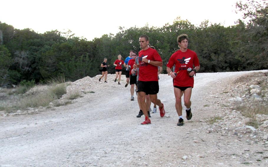 Runners work their way towards the end of a three-mile trail at Team Red, White & Blue's November running camp.