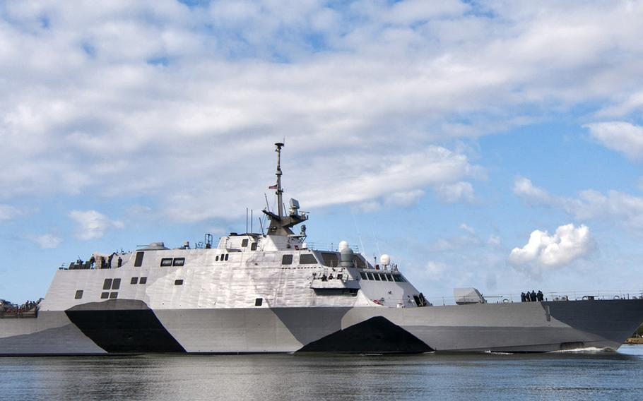 In this photo provided by the U.S. Navy, the USS Freedom littoral combat ship pulls into Pearl Harbor, Hawaii. The USS Freedom, which  is stopping in Hawaii on its way to a deployment to Singapore, has advantages bigger U.S. Navy ships lack.