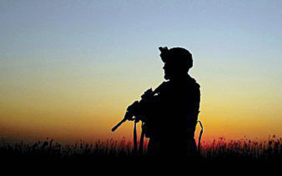 Silhouette of a soldier preparing to leave the battlefield.