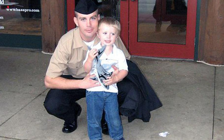 Daniel Hair, seen prior to his separation from the Navy with his son, says he began experiencing medical problems five months after participating in Japan's earthquake relief efforts. He has joined 50 other sailors and Marines who are suing the Tokyo Electric Power Co., for allegedly lying to the U.S. military about the dangers its troops faced in the days following the March 2011 earthquake and subsequent nuclear disaster in Fukushima.