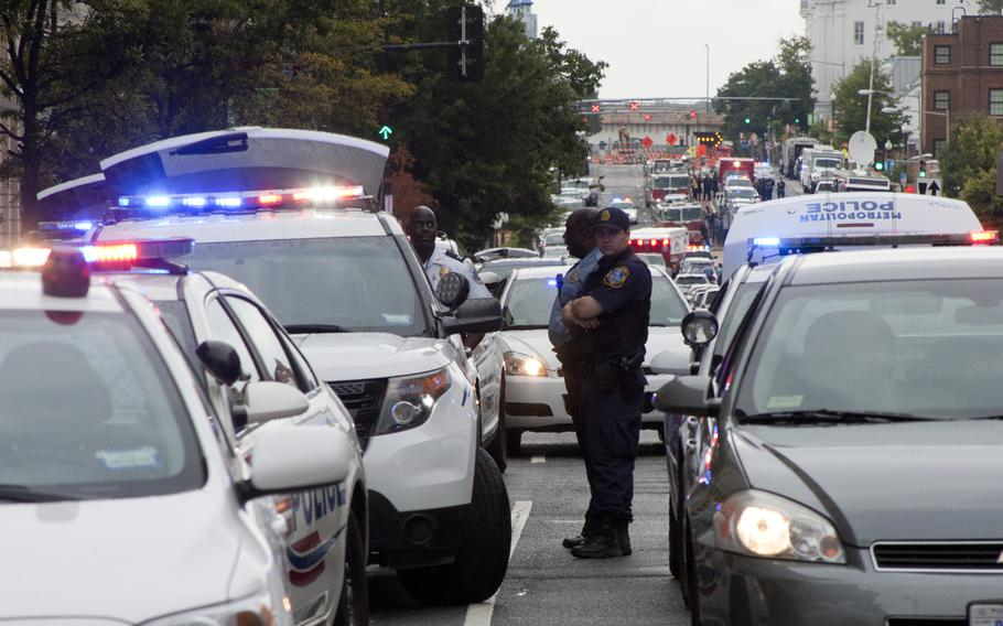 Police respond to the scene of a shooting rampage at Washington Navy Yard that left 12 victims dead on Sept. 16, 2013.