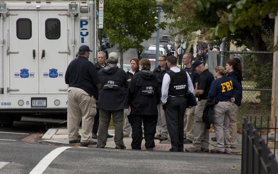 The FBI respond to the scene of a shooting at the Washington Navy Yard that left 13 people dead on Sept. 16, 2013.