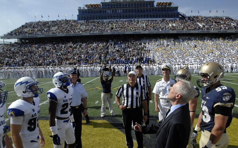 All eyes are on the coin tossed by Secretary of the Navy Ray Mabus before the game between Air Force and Navy at Annapolis, Md. on October 5, 2013.