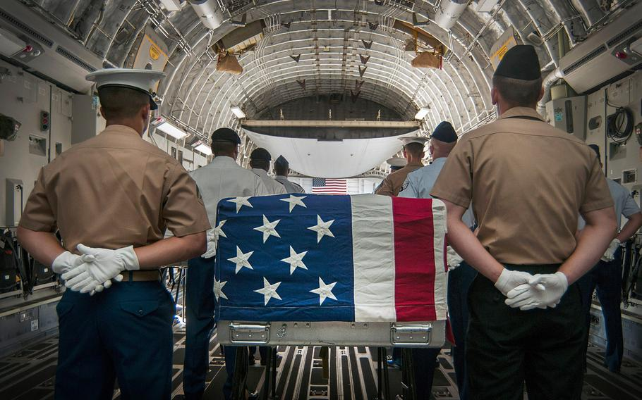 An honor detail comprised of joint military members prepares to escort the remains of fallen servicemembers who died during World War II and the Vietnam War during an arrival ceremony April 26, 2013, hosted by the U.S. Joint POW/MIA Accounting Command.